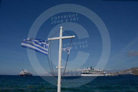 View of the Celebrity Constellation cruise ship from Mykonos harbour, with Greek flag flying